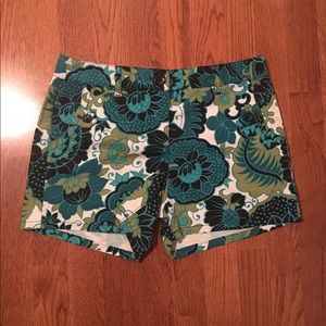Tropical print shorts.